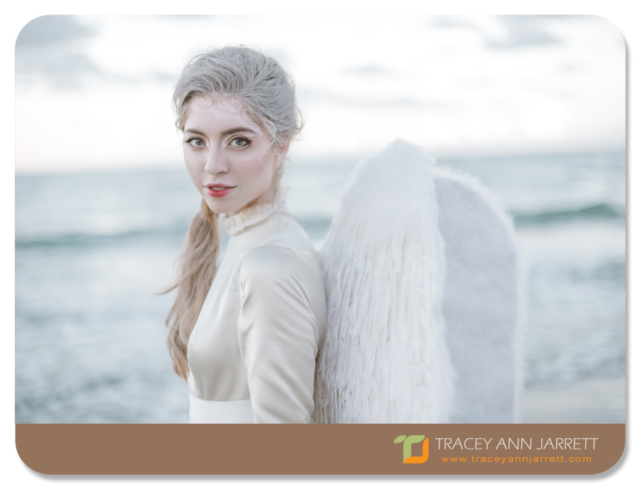angel themed shoot of model on the beach
