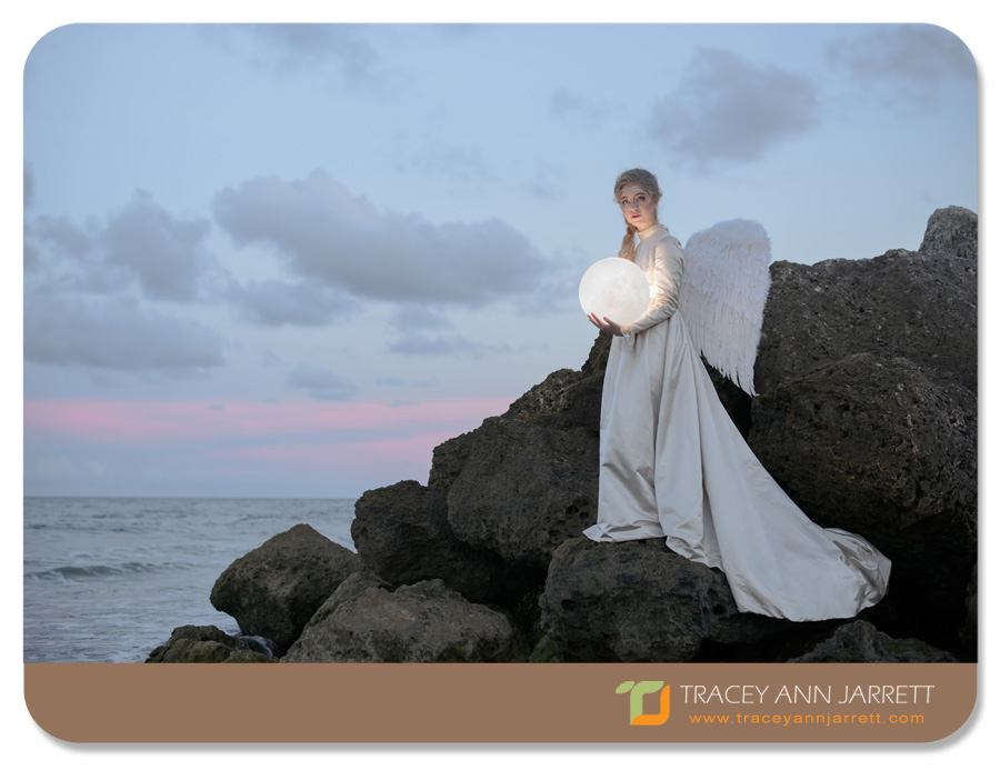 south florida whimsical portrait session of angel on the beach with fairy lights