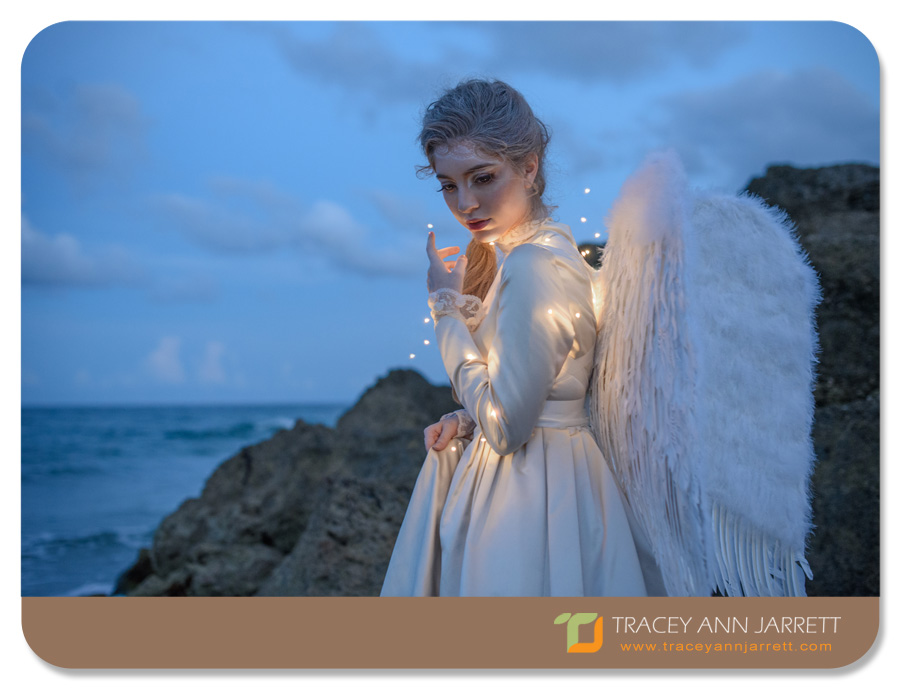 creative portrait photography of angel on the beach rescuing the moon